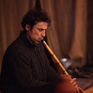 Playing ney (Turkish reeed flute)